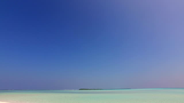 v01074 Maldives beautiful beach background white sandy tropical paradise island with blue sky sea water ocean 4k video