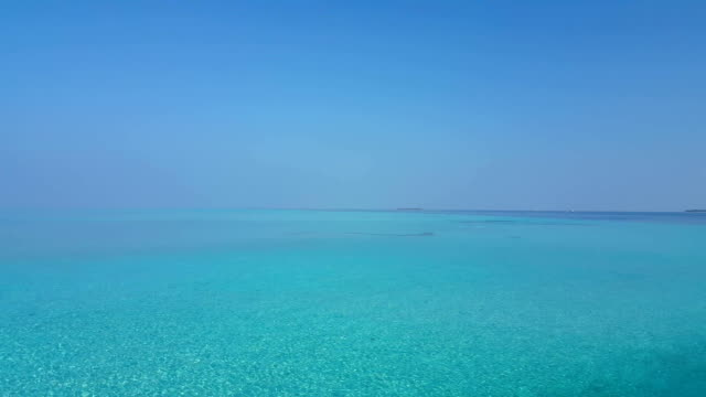 v01077 Maldives beautiful beach background white sandy tropical paradise island with blue sky sea water ocean 4k video