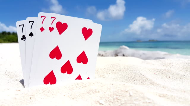 v01119 Maldives beautiful beach background white sandy tropical paradise island with blue sky sea water ocean 4k playing cards sevens video