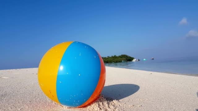 v01129 Maldives beautiful beach background white sandy tropical paradise island with blue sky sea water ocean 4k ball video