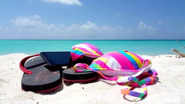 v01163 Maldives beautiful beach background white sandy tropical paradise island with blue sky sea water ocean 4k flip flops bikini phone video