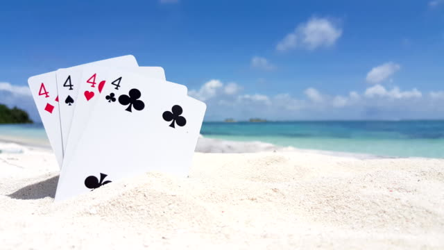 v01259 Maldives beautiful beach background white sandy tropical paradise island with blue sky sea water ocean 4k playing cards fours video