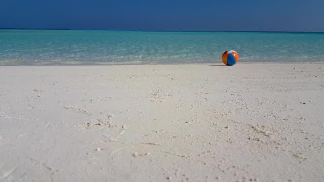 v01493 Maldives beautiful beach background white sandy tropical paradise island with blue sky sea water ocean 4k ball video
