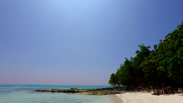 v01584 Maldives beautiful beach background white sandy tropical paradise island with blue sky sea water ocean 4k video