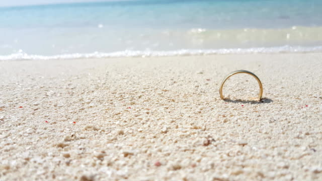 v01687 Maldives beautiful beach background white sandy tropical paradise island with blue sky sea water ocean 4k gold wedding ring video