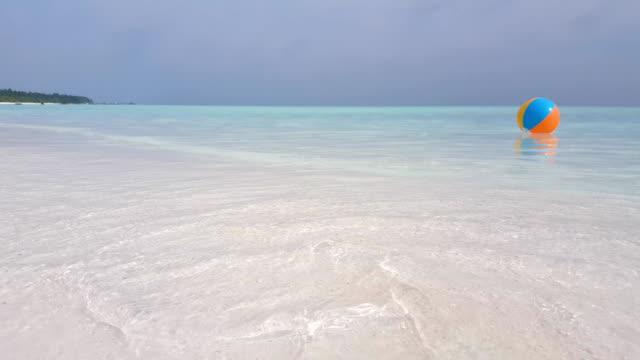 v02413 Maldives beautiful beach background white sandy tropical paradise island with blue sky sea water ocean 4k ball video