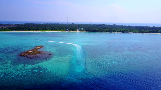 v03423 Aerial flying drone view of Maldives white sandy beach on sunny tropical paradise island with aqua blue sky sea water ocean 4k boat sailing video