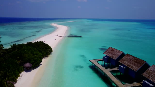 v03644 Aerial flying drone view of Maldives white sandy beach on sunny tropical paradise island with aqua blue sky sea water ocean 4k luxury 5 star resort hotel water bungalow hut relaxing holiday vacation video