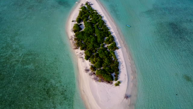 v04226 Aerial flying drone view of Maldives white sandy beach on sunny tropical paradise island with aqua blue sky sea water ocean 4k video