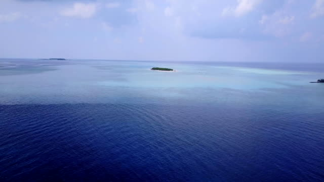 v04510 Aerial flying drone view of Maldives white sandy beach on sunny tropical paradise island with aqua blue sky sea water ocean 4k video
