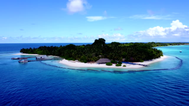 v04530 Aerial flying drone view of Maldives white sandy beach on sunny tropical paradise island with aqua blue sky sea water ocean 4k video