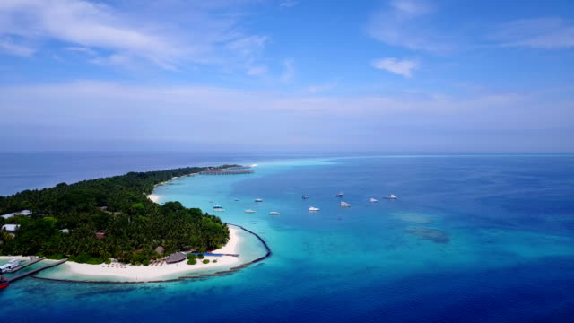 v04607 Aerial flying drone view of Maldives white sandy beach on sunny tropical paradise island with aqua blue sky sea water ocean 4k video