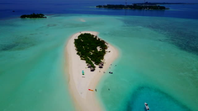 v04642 Aerial flying drone view of Maldives white sandy beach on sunny tropical paradise island with aqua blue sky sea water ocean 4k video