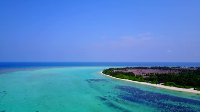 v04677 Aerial flying drone view of Maldives white sandy beach on sunny tropical paradise island with aqua blue sky sea water ocean 4k video