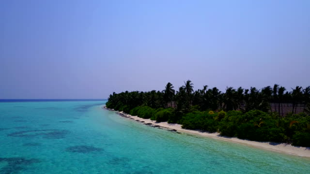 v04930 Aerial flying drone view of Maldives white sandy beach on sunny tropical paradise island with aqua blue sky sea water ocean 4k video