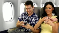 Vacation Couple Toasting On Airplane video