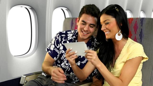 Vacationing Couple Looking At Photos video