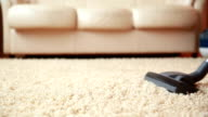 Vacuum cleaner cleaning the carpet, dolly shot video