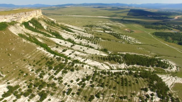 Valley at the foot of white mountains, aerial video video
