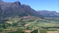 Valley Leading To Franschhoek  - Aerial View - Western Cape,  Cape Winelands District Municipality,  Stellenbosch,  South Africa video