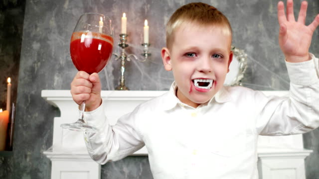 vampire boy, child in dracula costume with glass of blood, halloween costume, dangerous child video