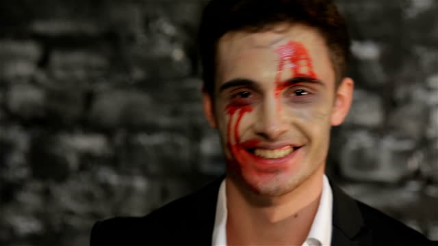 Vampire man shows a  business card video