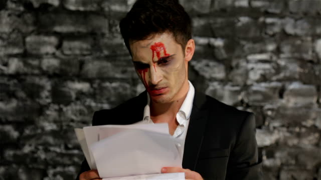 Vampire reads and tears paper in anger video