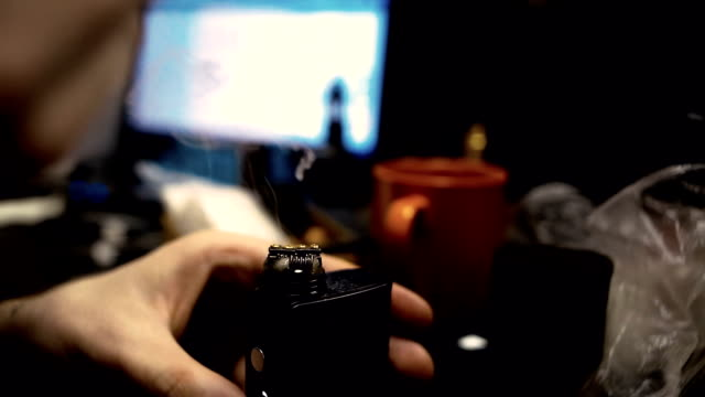Vape after-sales service of the electronic cigarette. Male hands add liquid with nicotine for vaping. video