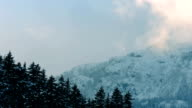Vapor Catching Sunlight Near Snowy Mountain video