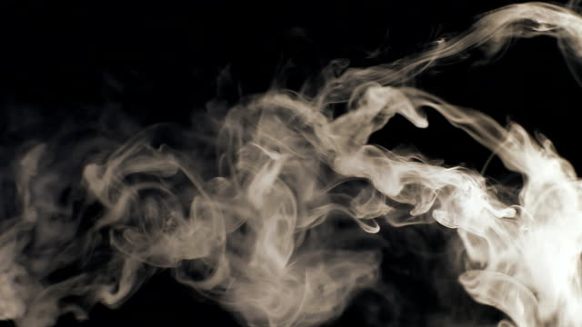 Vapor like smoke at sepia on a dark black background. Vape smoke rings in motion at vape clouds. video
