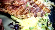 Variation of lamb fillet and chop on asparagus cream with roasted couscous video