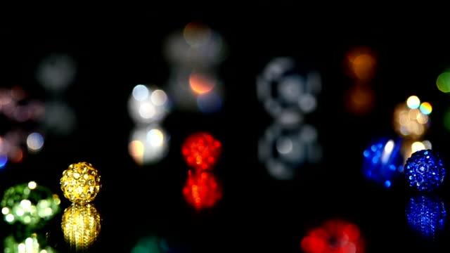 Varicoloured beads on black background video
