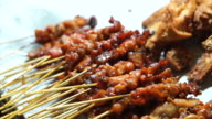 Variety kind of Thai bbq skewers selling at local market video
