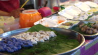 Variety of assorted Thai traditional desserts selling in local market video