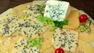 Variety of cheeses on a wooden board video