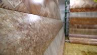 Variety of linoleum rolls in flooring warehouse video