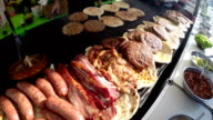 Various Delicious Meat on a Large Barbecue Hot Smoky Grill video