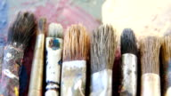 Various paint brushes on table video