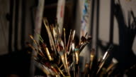 Various paintbrushes soiled with paints closeup video