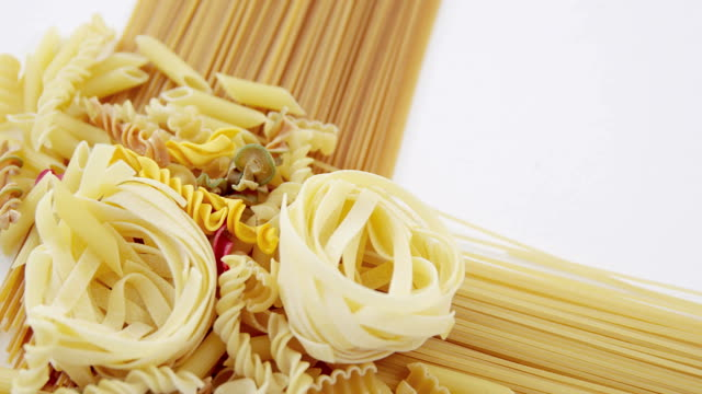 Various pasta and spaghetti on white background video