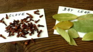 Various spices on old brown wooden table video