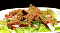 Vegetable salad on a plate rotation video