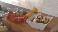 Vegetable salad on plate on the kitchen counter video