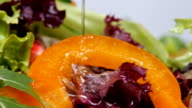 Vegetable salad with olive oil pouring. Slow motion. video