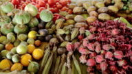 Vegetables and herbs are sold in the bazaar. video