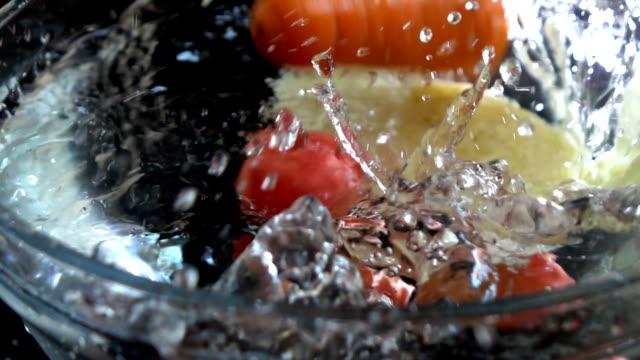Vegetables and water splashing video