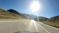 Vehicle point-of-view driving on Highwaytoward sun video