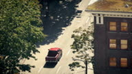 Vehicles Passing Next To Apartment From Above video