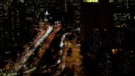 AERIAL, CLOSE UP: Vehicles traveling along Brooklyn Bridge overpass at night video