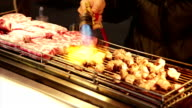 Vendor cooking beef with blowtorch at Lehua Night Market video